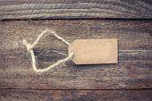 Label on old wood background. Toned image.