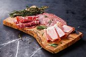 Cold Meat Plate With Prosciutto And Salami On Olive Wood Board On Dark Marble Background
