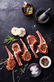 Raw Meat Mutton Lamb Ribs With Herbs On Black Marble Background