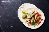 Tortillas Filled With Chicken And Fresh Vegetables On Dark Marble Background