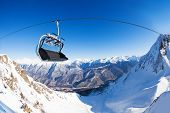 stock photo of caucus  - Close view of ski lift chair over the valley panorama on winter resort in Sochi - JPG