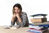 image of overwhelming  - young stressed student girl studying pile of books on library desk preparing MBA test or exam in stress feeling tired and overwhelmed in youth education concept - JPG