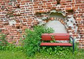 Red Bench by medieval 13th century brick ruin