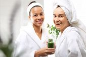 Friends in the spa salon healthy diet green smoothie