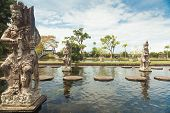 stock photo of fountain grass  - Tirtagangga water palace with fountains  and ponds on Bali - JPG