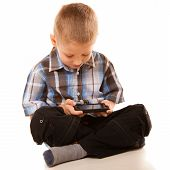 Little Boy Playing Games On Smartphone