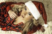 Pretty Blonde Girl In Christmas Red Robe & Santa Hat