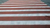 image of many red and white lines on road at day