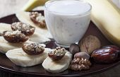 Bananas With Dates , Nuts And A Cup Of Yogurt.