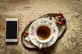 Top View Of Smartphone And Cup Of Tea