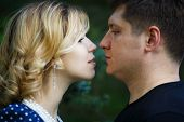 picture of freckle face  - Young happy couple face to face in a park