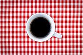 A Cup Of Black Coffee On A Chess Background