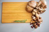 Closeup On Mushrooms On Cutting Board