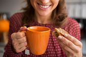 Closeup On Young Housewife Drinking Tea With Freshly Baked Pumpkin Bread With Seeds