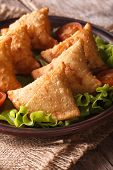 Samosa With Lettuce On A Wooden Table. Vertical Closeup