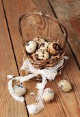 Quail Eggs In A Basket On A Wooden Table