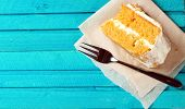 Carrot Cake With Fork On A Blue Wooden Table