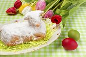 stock photo of spring lambs  - Easter lamb cake and colorful Easter eggs - JPG