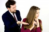 stock photo of punishment  - Father punishing daughter isolated in studio angry - JPG