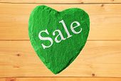green heart with sale writing