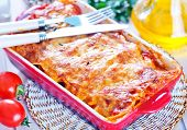 stock photo of lasagna  - lasagna in bowl and on a table - JPG