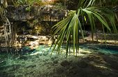 X-batun Cenote - Natural Lagoon With Transparent Turquoise Water Surrounded By Rocks