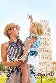 Happy Mother And Baby Girl With Map In Front Of Leaning Tower Of