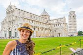 Portrait Of Happy Young Woman On Piazza Dei Miracoli, Pisa, Tusc
