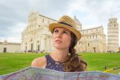Young Woman With Map On Piazza Dei Miracoli, Pisa, Tuscany, Ital