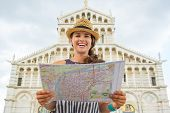 Portrait Of Smiling Young Woman With Map In Front Of Duomo Di Pi