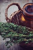 Pharmacy Bottle And Thyme In A Basket