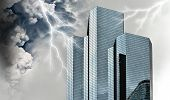 picture of storms  - Financial and economic crisis concept with giant storm over financial buildings - JPG