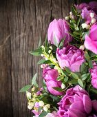 Bouquet Of Fresh Pink Tulips And Lily Of The Valley On Aged Wooden Table