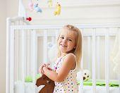 Little Cute Girl In Nursery Room