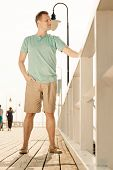 Fashion Portrait Of Handsome Man On Pier