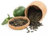 Pumpkin Seeds In A Basket And Pumpkin