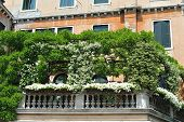 stock photo of mansion  - viewof balcony of mansion decorated with flowers - JPG
