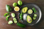 stock photo of cucumber slice  - Sliced avocado - JPG