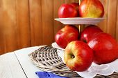 image of serving tray  - Tasty ripe apples on serving tray on wooden background - JPG