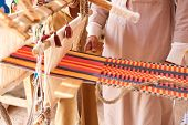 stock photo of nomads  - A man produces the fabric on a traditional loom in the Bedouin village Egypt - JPG
