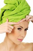 stock photo of forehead  - Beauty woman checking wrinkles on her forehead - JPG