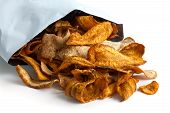 foto of parsnips  - Opened packet of fried parsnip and carrot chips on white surface - JPG