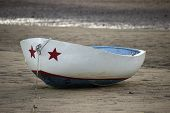 picture of cape-cod  - A patriotic row boat decorated with stars and stripes on the beach in Provincetown - JPG