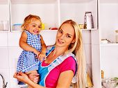 pic of child feeding  - Mother  feed happy child on hand at kitchen  - JPG
