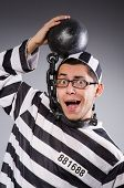 picture of prison uniform  - Funny prisoner in chains isolated on gray - JPG