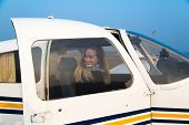 picture of single woman  - Woman pilot of the single engine piston aircraft - JPG