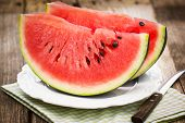 picture of watermelon slices  - Fresh watermelon slices on the plate  close up - JPG
