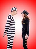 stock photo of inmate  - Police and prison inmate against the gradient - JPG