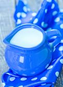 stock photo of jug  - fresh milk in jug and on a table - JPG