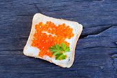 picture of banquette  - bread with caviar on the wooden table - JPG